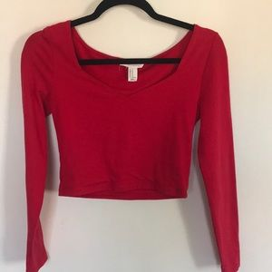 A red cropped long sleeved shirt